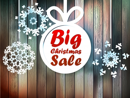 sales person: Christmas snowflakes with big sale over wooden background.
