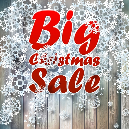 Christmas snowflakes with big sale over wooden background.