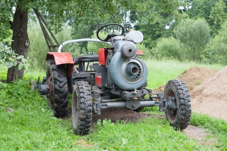 selfmade: Self-made tractor under apple tree