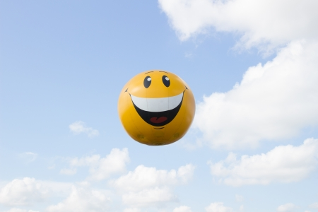 Big smiling air balloon in sky