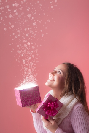 Beautiful woman opens her christmas present photo