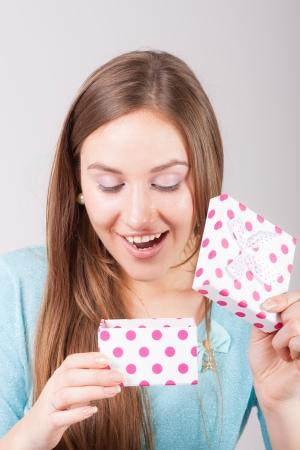 Beautiful woman opens the gift photo