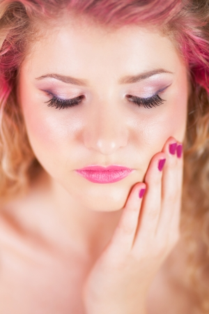 Attractive woman with colorful makeup and hairstyle, focus on eyelashes photo