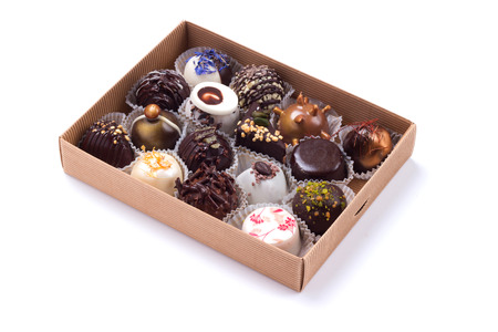 Box of handicrafted truffles isolated on white background