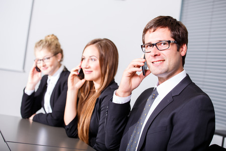 phonecall: Business people having phonecall in meeting Stock Photo