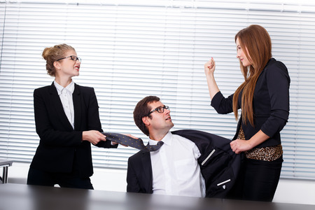 women fighting: Women fighting for a man in office Stock Photo