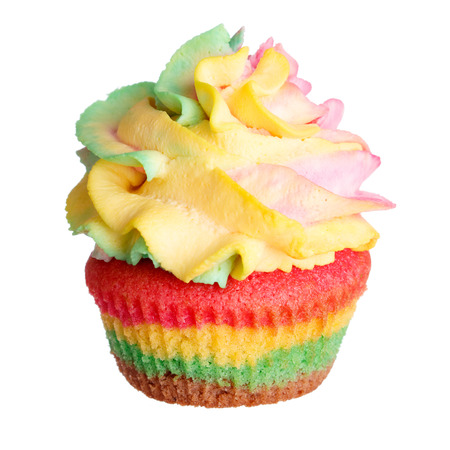 Rainbow colored muffin isolated on white background photo