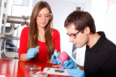 deposition: Scientists working with deposition substrates Stock Photo