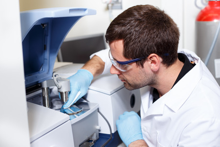 scientist conducting research in a lab environment