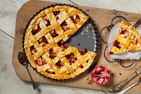 apple tart: American pie with apple,foxberry and pomegranate seeds ingredient Stock Photo