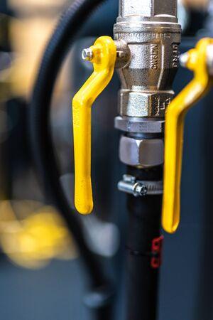 Yellow valves / yellow levers Stock Photo
