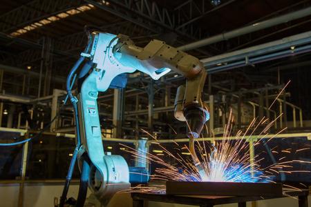 Robot is welding part in automotive factory Stock Photo