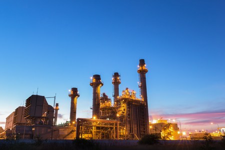 Gas turbine electrical power plant at dusk with twilight Banco de Imagens