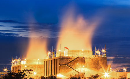 Water cooling systems tower for gas turbine electric power plant with blue hour. Stock Photo