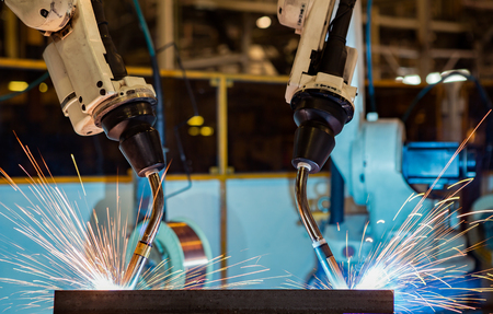 Close-up industrial robot are test run new program in automotive assembly factory Standard-Bild