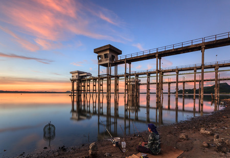Fisherman and water supply station in Chonburi Thailand Stock Photo