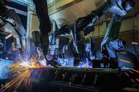 Team robots welding assembly automotive part