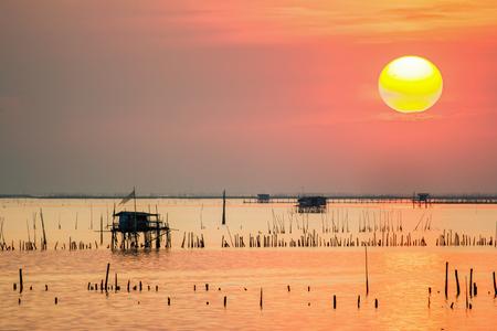 Fisherman village at sea with sunset Stock fotó
