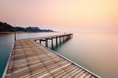 Wooden bridge at the sea at sunrise