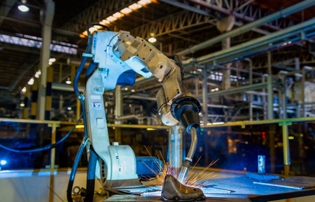 Industrial robot is welding assembly automotive part in factory