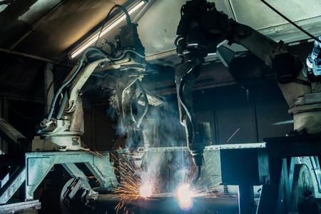 industrial robots are welding in factory