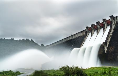 Water spilling over the dam Stock fotó