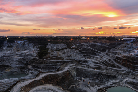 opencast mining quarry with beautiful sunlight and cloudy sky