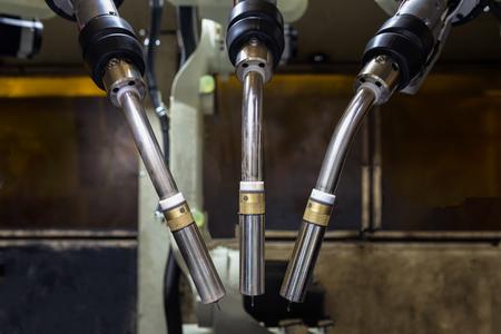 Team robots welding in teaching mode with new program