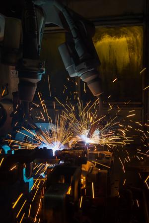 robot welding part in automotive industrial Фото со стока