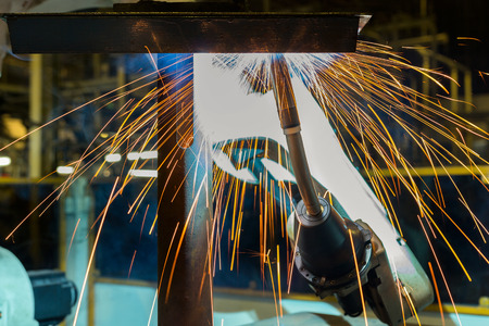 Industrial robot is welding assembly automotive part in car factory Stock fotó