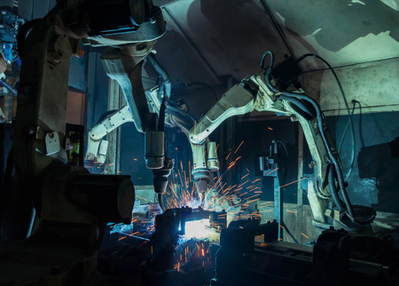 Industrial welding robots are movement in production line factory Stock fotó