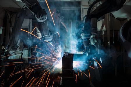 Industrial robot is movement welding steel part in factory