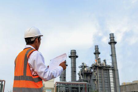 Engineer is checking gas turbine power plant Stock fotó