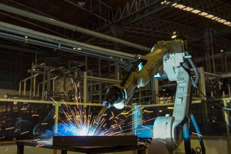 Robot is welding part in automotive factory Stock fotó