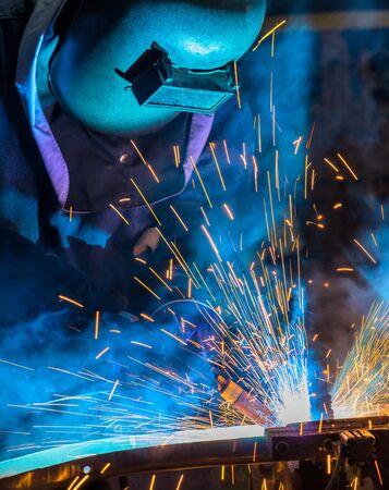Industrial worker is welding metal in factory Stock fotó