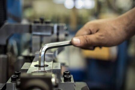Worker is used Hexagonal screwdriver in factory