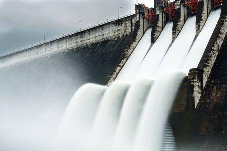 Water spills over the top of Dam Stock fotó