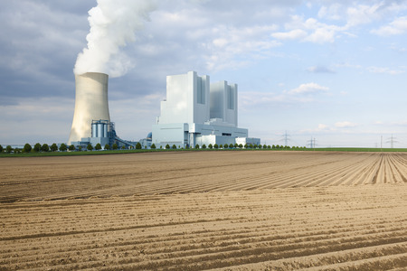 lignite: A shiny new lignite power station behind an empty field Stock Photo