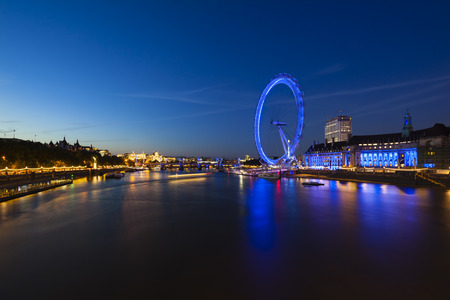 Thames River with view to the City of London and the London Eye with reflection at night