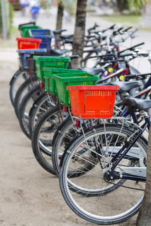 rented: Parked rental bicycles with colorful baskets in La Digue, Seychelles