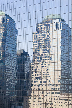 manhattan mirror new york: Reflections of skyscrapers in the facade of another skyscraper in Manhattan