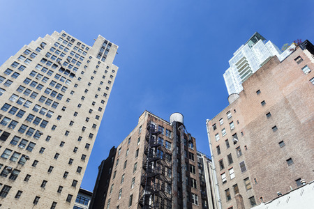 apartmant: Old skyscrapers in New York with deep blue sky Editorial