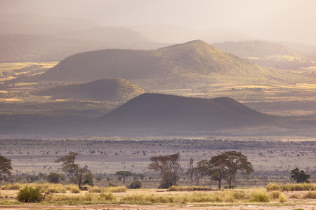 amboseli: Volcanic craters on the flank of Mount Kilimanjaro seen from Amboseli National Park in Kenya with beautiful evening light.