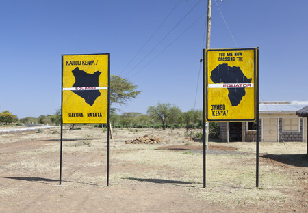 Famous signs when crossing the equator in Kenya.