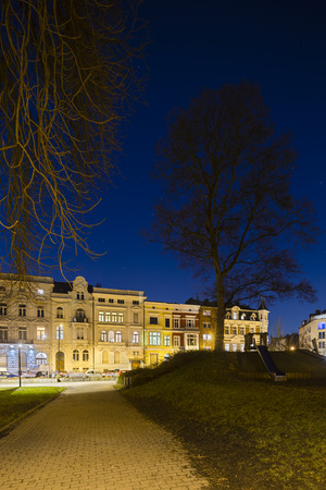 Old houses and a playground in the Frankenberger Viertel in Aachen, Germany at night. photo