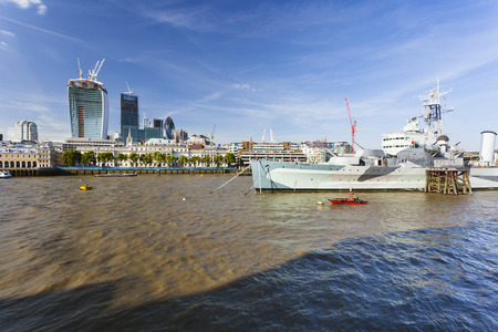 hms: View over the Thames River in London to the city with the HMS Belfast in the foreground