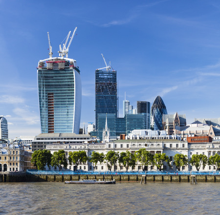 london skyline: View over the Thames River in London to the city with several new skyscrapers