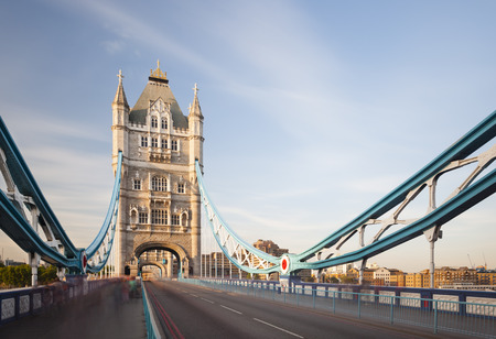 Long exposure shot of the Tower Bridge in London with blue sky.