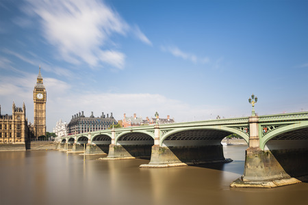 westminster bridge: Long exposure panorama of the Houses of Parliament in London with blue sky and the Westminster Bridge to the right.