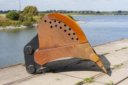 dredger: Large detached scoop of a floating dredger on the shore